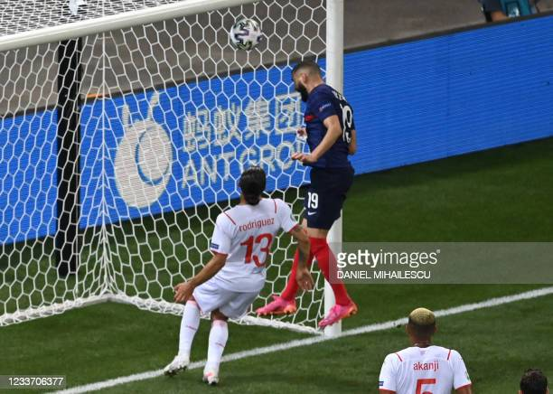 France's forward Karim Benzema scores the team's second goal during the UEFA EURO 2020 round of 16 football match between France and Switzerland at...