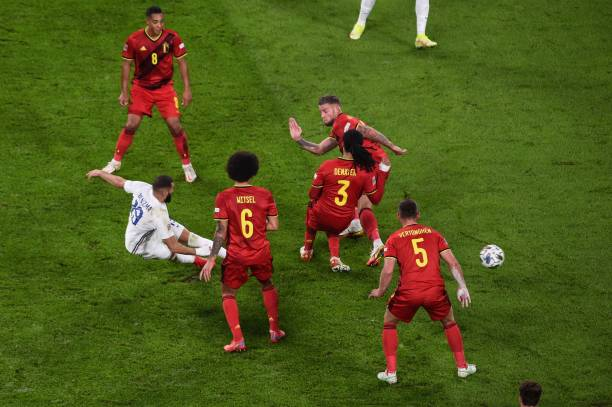 France's forward Karim Benzema shoots and scores a goal during the UEFA Nations League semi-final football match between Belgium and France at the...