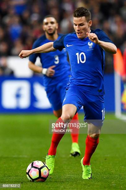 France's forward Kevin Gameiro runs with the ball during the friendly football match France vs Spain on March 28 2017 at the Stade de France stadium...