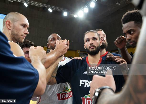 France's forward Kim Tillie shooting guard Nando de Colo forward Boris Diaw forward Joffrey Lauvergne and shooting guard Yakuba Quattara celebrate...