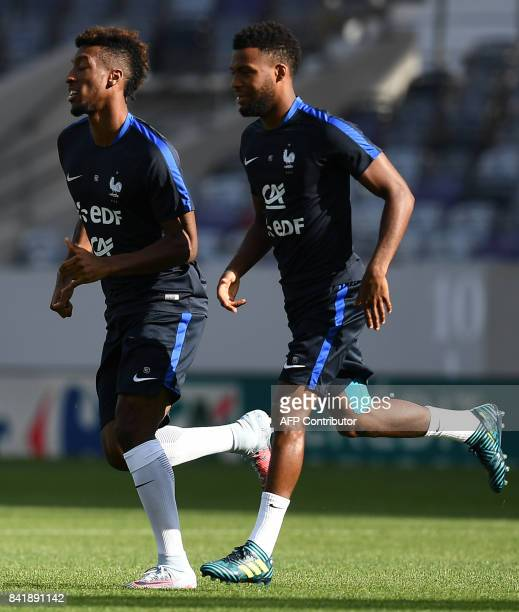 France's forward Kingsley Coman and France's forward Thomas Lemar take part in a training session at the Municipal Stadium in Toulouse southern...