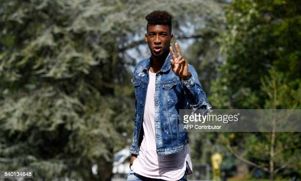 France's forward Kingsley Coman arrives at the French national football team training base in Clairefontaine on August 28 as part of the team's...