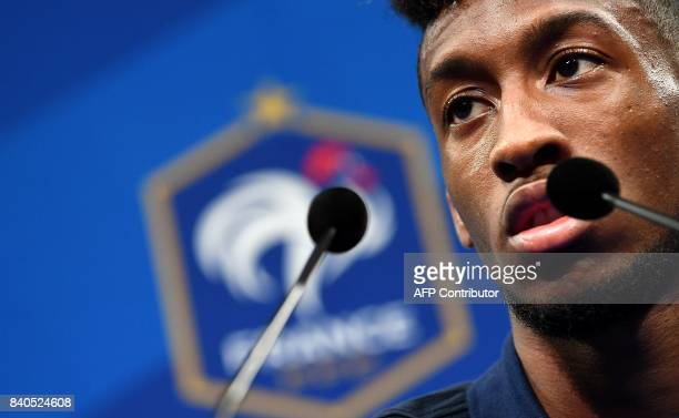 France's forward Kingsley Coman attends a press conference in Clairefontaine en Yvelines on August 29 as part of the team's preparation for the FIFA...