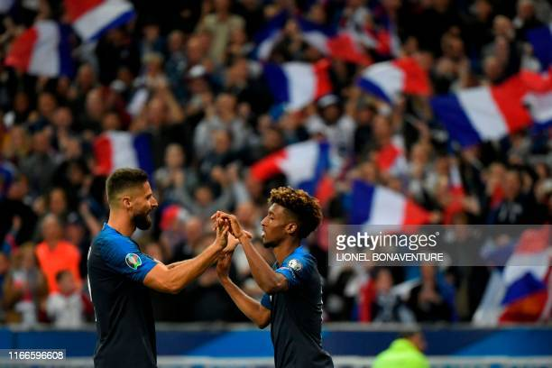 France's forward Kingsley Coman celebrates after scoring a goal with France's forward Olivier Giroud during the UEFA Euro 2020 qualifying Group H...