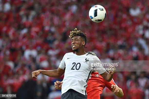 France's forward Kingsley Coman jumps for the ball with Switzerland's defender Ricardo Rodriguez during the Euro 2016 group A football match between...