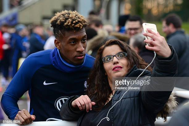 France's forward Kingsley Coman poses for a selfie with fans during a training session on March 21 2016 in Clairefontaine France The first day of...