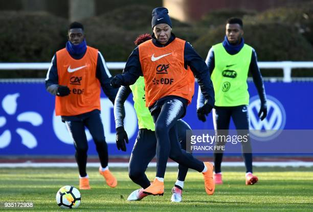 France's forward Kylain Mbappe vies with France's defender Presnel Kimpembe during a training session in Clairefontaine en Yvelines on March 20 as...