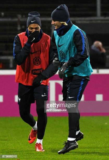 France's forward Kylian Mbappe and France's forward Antoine Griezmann warm up during a training session on the eve of the friendly match Germany v...