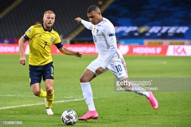 France's forward Kylian Mbappe and Sweden's midfielder Sebastian Larsson vie for the ball during the UEFA Nations League football match between...