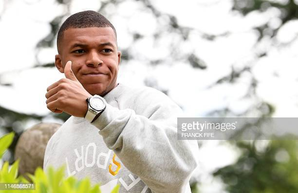 France's forward Kylian Mbappe arrives at the French national football team training base in ClairefontaineenYvelines on May 29 2019 as part of the...