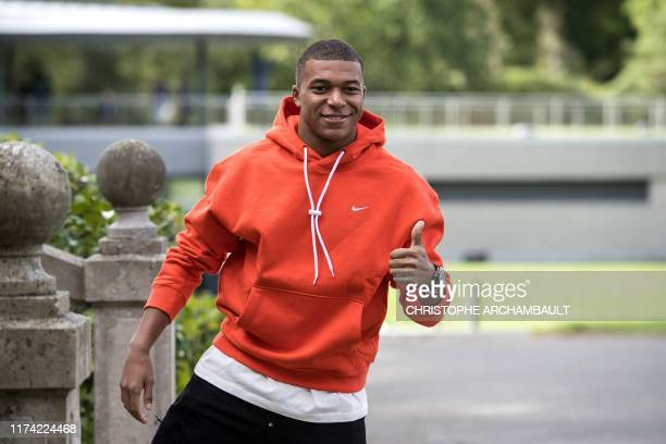 France's forward Kylian Mbappe arrives for a training session in Clairefontaine-en-Yvelines, southwest of Paris on October 7, 2019 ahead of the Euro...