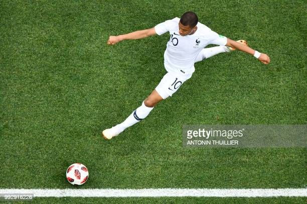 TOPSHOT France's forward Kylian Mbappe attempts a shot during the Russia 2018 World Cup quarterfinal football match between Uruguay and France at the...