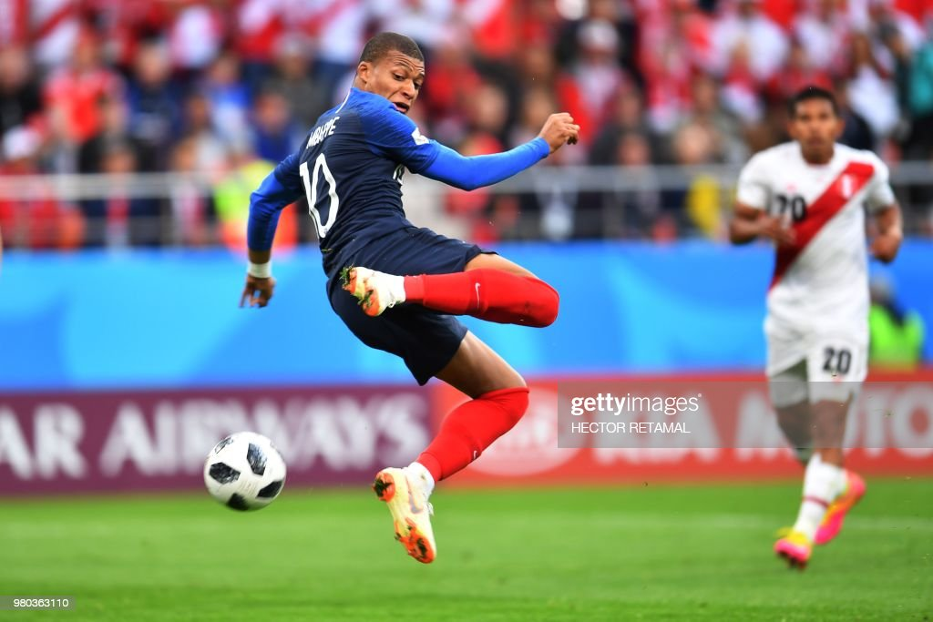 TOPSHOT - France's forward Kylian Mbappe attempts a shot on goal during the Russia 2018 World Cup Group C football match between France and Peru at the Ekaterinburg Arena in Ekaterinburg on June 21, 2018. (Photo by HECTOR RETAMAL / AFP) / RESTRICTED
