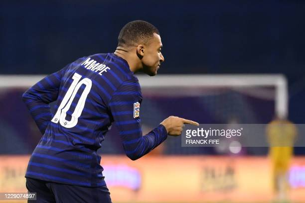 France's forward Kylian Mbappe celebrates after scoring a goal during the UEFA Nations League Group A3 football match between Croatia and France at...