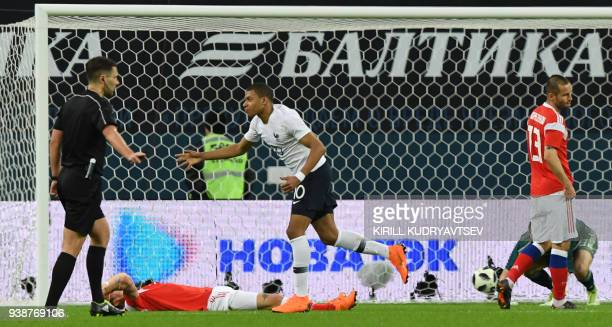 TOPSHOT France's forward Kylian Mbappe celebrates after scoring a goal during an international friendly football match between Russia and France at...