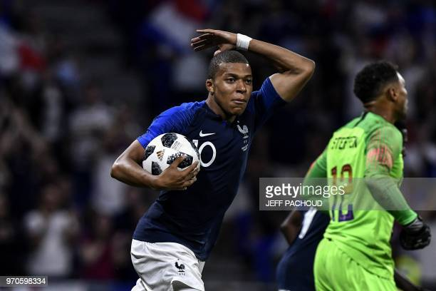 TOPSHOT France's forward Kylian MBappe celebrates after scoring a goal during the friendly football match between France and USA at the at the Parc...