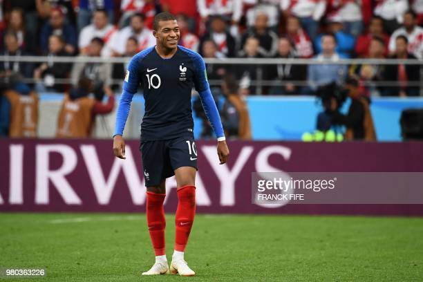 France's forward Kylian Mbappe celebrates after scoring a goal during the Russia 2018 World Cup Group C football match between France and Peru at the...