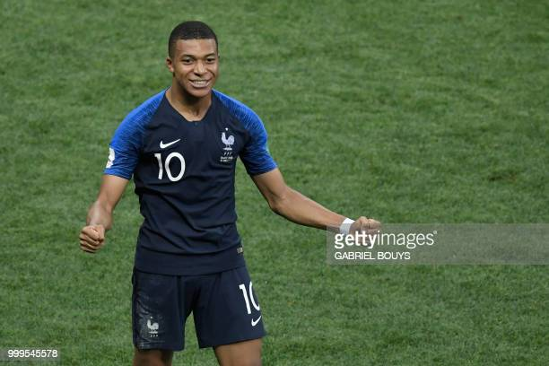 France's forward Kylian Mbappe celebrates after scoring a goal during the Russia 2018 World Cup final football match between France and Croatia at...