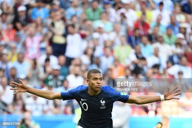 TOPSHOT France's forward Kylian Mbappe celebrates after scoring their fourth goal during the Russia 2018 World Cup round of 16 football match between...