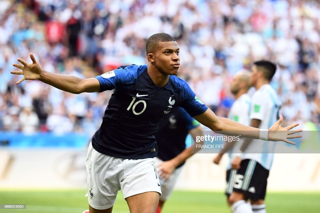 TOPSHOT - France's forward Kylian Mbappe celebrates after scoring their third goal during the Russia 2018 World Cup round of 16 football match between France and Argentina at the Kazan Arena in Kazan on June 30, 2018. (Photo by FRANCK FIFE / AFP) / RESTRICTED