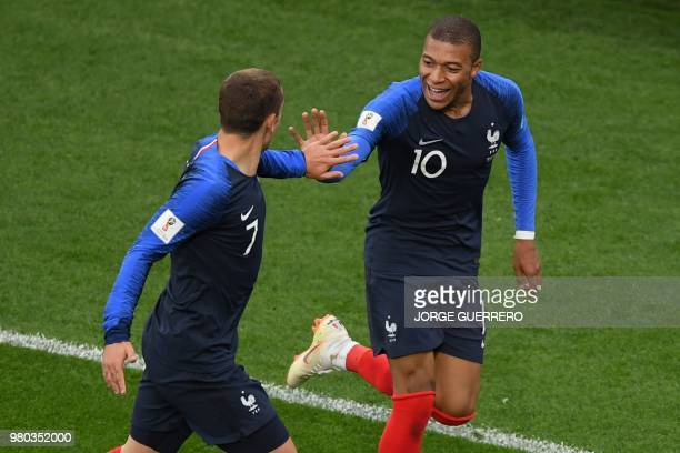 TOPSHOT France's forward Kylian Mbappe celebrates his goal with France's forward Antoine Griezmann during the Russia 2018 World Cup Group C football...