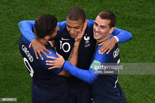 TOPSHOT France's forward Kylian Mbappe celebrates his goal with teammates Olivier Giroud and Antoine Griezmann during the Russia 2018 World Cup Group...
