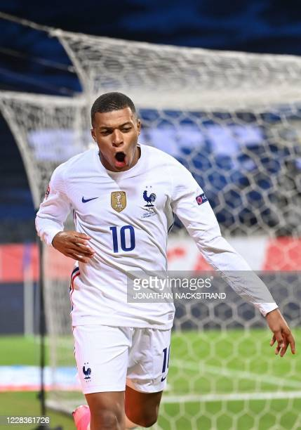 France's forward Kylian Mbappe celebrates scoring the opening goal during the UEFA Nations League football match between Sweden and France on...