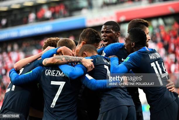TOPSHOT France's forward Kylian Mbappe celebrates scoring the opening goal with his teammates during the Russia 2018 World Cup Group C football match...