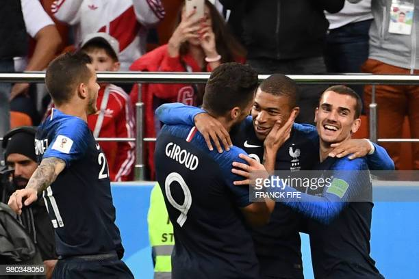 TOPSHOT France's forward Kylian Mbappe celebrates with teammates after scoring a goal during the Russia 2018 World Cup Group C football match between...
