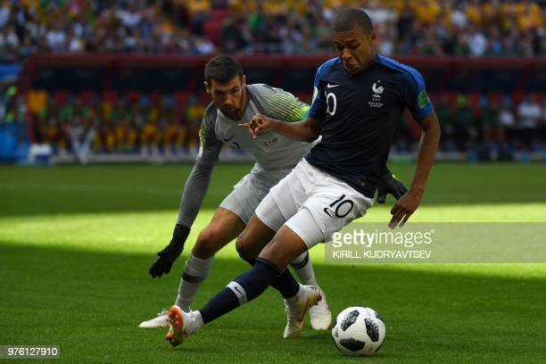 TOPSHOT France's forward Kylian Mbappe controls the ball as he is marked by Australia's goalkeeper Mathew Ryan during the Russia 2018 World Cup Group...