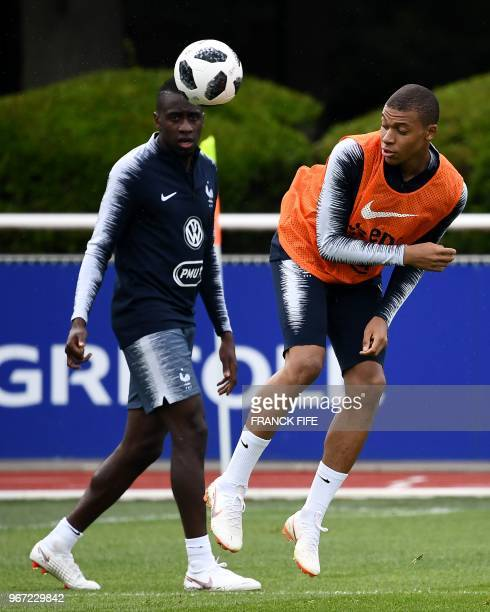 France's forward Kylian Mbappe controls the ball during a training session in ClairefontaineenYvelines on June 4 as part of the team's preparation...