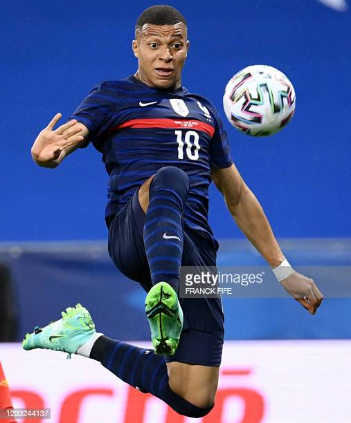 France's forward Kylian Mbappe controls the ball during the friendly football match between France and Wales at the Allianz Riviera Stadium in Nice,...