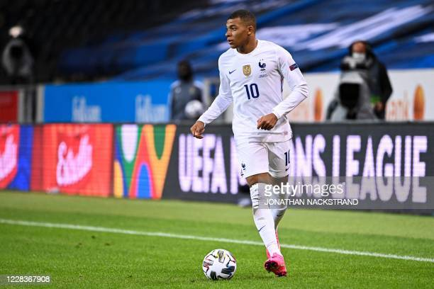 France's forward Kylian Mbappe controls the ball during the UEFA Nations League football match between Sweden and France on September 5, 2020 at the...