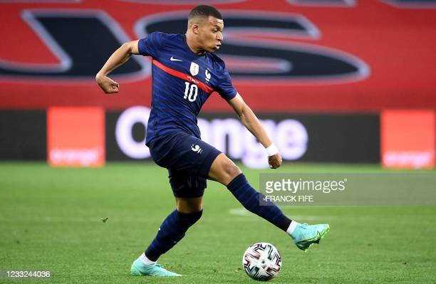 France's forward Kylian Mbappe dribbles during the friendly football match between France and Wales at the Allianz Riviera Stadium in Nice, southern...