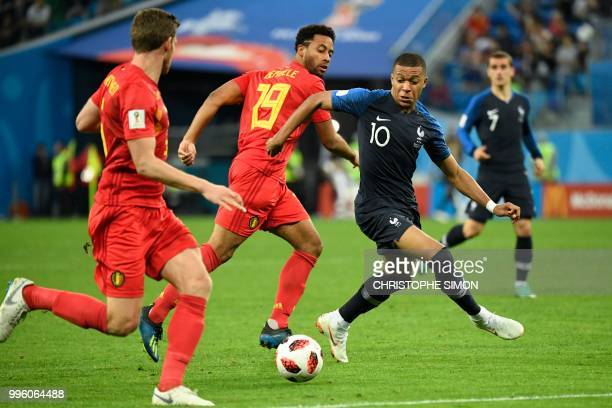 TOPSHOT France's forward Kylian Mbappe eyes the ball next to Belgium's midfielder Moussa Dembele during the Russia 2018 World Cup semifinal football...
