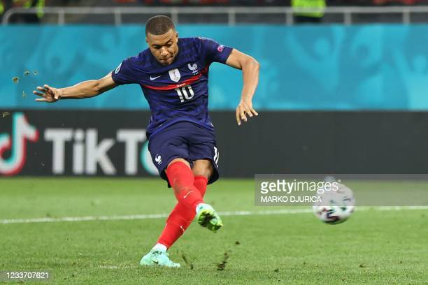 France's forward Kylian Mbappe fails to convert a penalty during the UEFA EURO 2020 round of 16 football match between France and Switzerland at the...