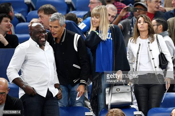 France's forward Kylian Mbappe father Wilfried Mbappe French TV presenter Nagui and his wife Melanie Page and Claude Deschamps wife of France's coach...