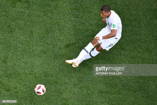 France's forward Kylian Mbappe passes the ball during the Russia 2018 World Cup quarterfinal football match between Uruguay and France at the Nizhny...