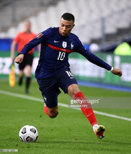 France's forward Kylian Mbappe plays the ball during the FIFA World Cup Qatar 2022 qualification football match between France and Ukraine at the...