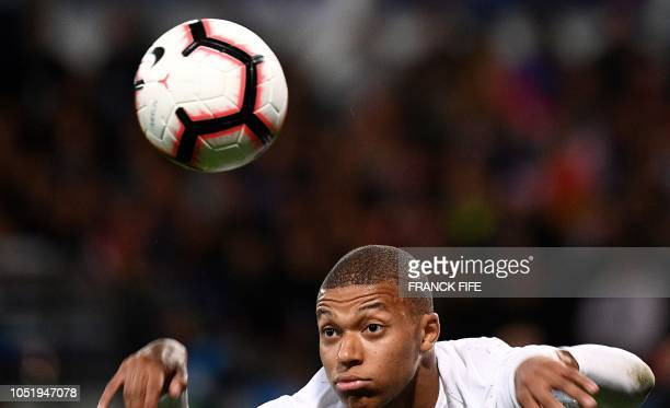 France's forward Kylian Mbappe plays the ball during the friendly football match between France and Iceland at the Roudourou Stadium in Guingamp...