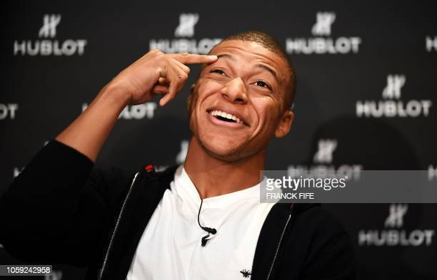 TOPSHOT France's forward Kylian MBappe poses during a photo session after an interview with AFP in which he announced the formalization of his...
