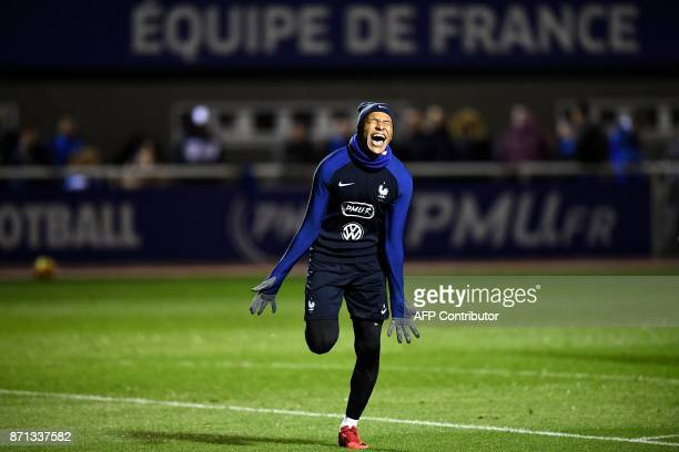 France's forward Kylian Mbappe reacts after scoring a goal during a training session in Clairefontaine-en-Yvelines near Paris on November 7, 2017 as...