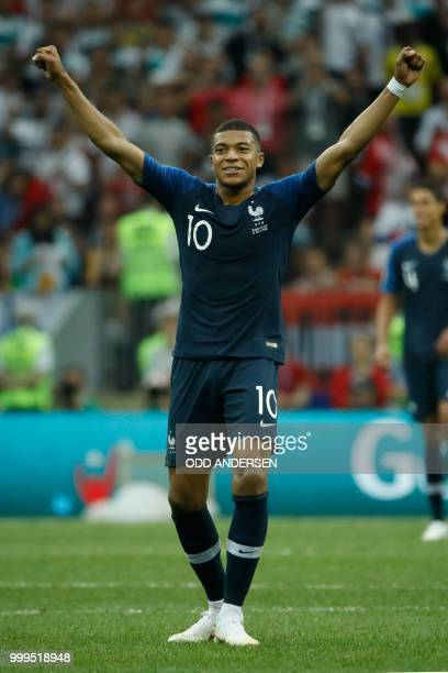 France's forward Kylian Mbappe reacts after the final whistle of the Russia 2018 World Cup final football match between France and Croatia at the...