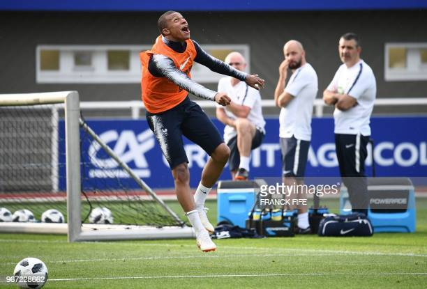 France's forward Kylian Mbappe reacts during a training session in ClairefontaineenYvelines on June 4 as part of the team's preparation for the...