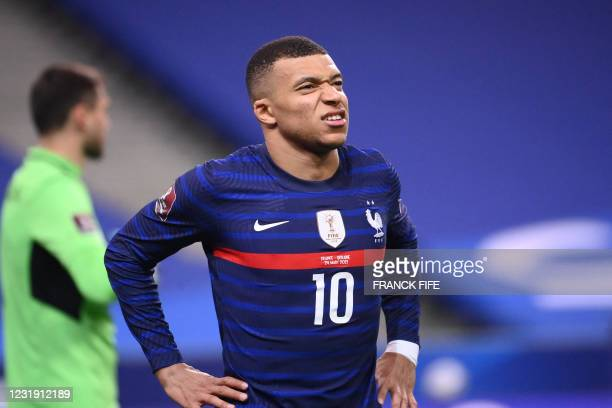 France's forward Kylian Mbappe reacts during the FIFA World Cup Qatar 2022 qualification football match between France and Ukraine at the Stade de...