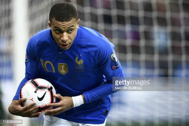 France's forward Kylian Mbappe reacts during the UEFA Euro 2020 Group H qualification football match between France and Iceland at the Stade de...
