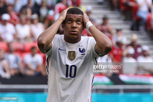 France's forward Kylian Mbappe reacts during the UEFA EURO 2020 Group F football match between Hungary and France at Puskas Arena in Budapest on June...
