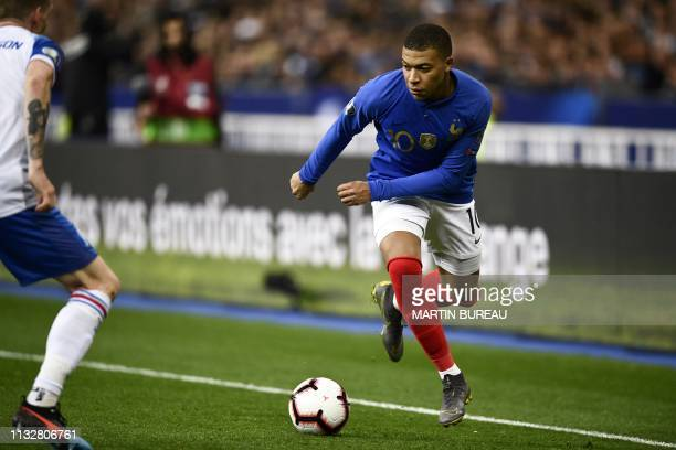 France's forward Kylian Mbappe runs for the ball during the UEFA Euro 2020 Group H qualification football match between France and Iceland at the...