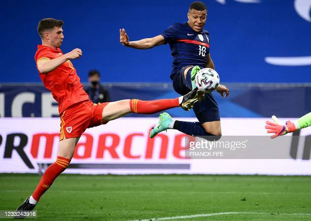 France's forward Kylian Mbappe scores a goal during the friendly football match between France and Wales at the Allianz Riviera Stadium in Nice,...