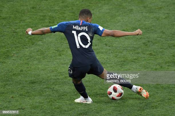 France's forward Kylian Mbappe scores a goal during the Russia 2018 World Cup final football match between France and Croatia at the Luzhniki Stadium...